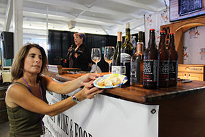 Debbie Gioquindo and Debbie Decker pairing wine and cheese